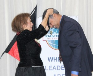 Andre receives his DTM from District Director Leonor Ragan