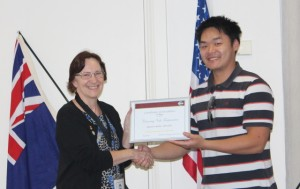 President Dennis Foo accepts 3rd place for the best Newsletter in the District from PRM Almarie Meyer